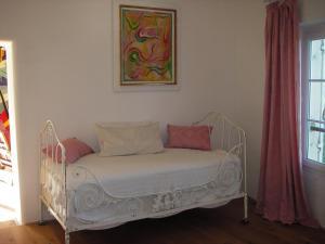 Un ou plusieurs lits dans un hébergement de l'établissement Pavillon de Beauregard