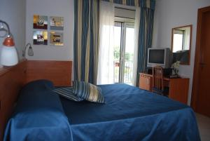 A bed or beds in a room at Telma Hotel