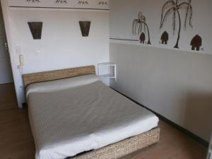 Un ou plusieurs lits dans un hébergement de l'établissement Hôtel Paradis