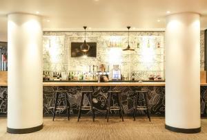 A kitchen or kitchenette at ibis Portsmouth