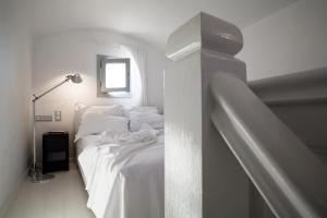 Ένα ή περισσότερα κρεβάτια σε δωμάτιο στο The Majestic Hotel