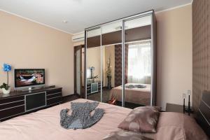 Кровать или кровати в номере Vizavi Apartments