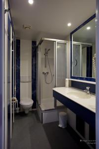 Ein Badezimmer in der Unterkunft Garni-Hotel zum alten Ratskeller
