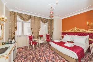 Кровать или кровати в номере The Galataport Hotel