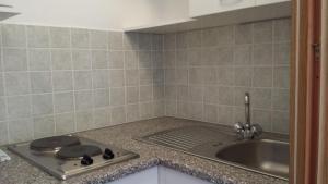 Kuchyňa alebo kuchynka v ubytovaní Studio-Ap Mia