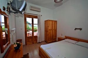Ένα ή περισσότερα κρεβάτια σε δωμάτιο στο Athina Apartments