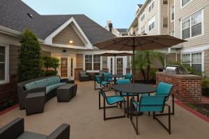 A porch or other outdoor area at Residence Inn by Marriott Orlando East/UCF Area