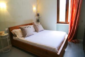 Letto o letti in una camera di Borgo Tiedoli