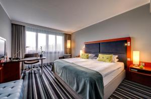 A bed or beds in a room at Radisson Blu Hotel Dortmund