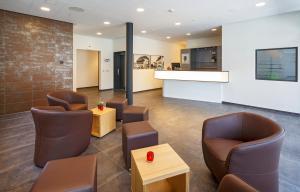 Лобби или стойка регистрации в Villmergen Swiss Quality Hotel
