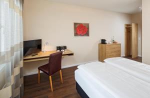 Кровать или кровати в номере Villmergen Swiss Quality Hotel