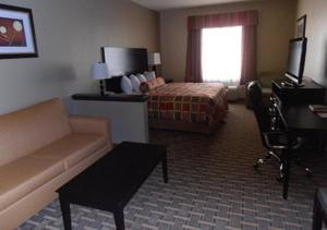 A television and/or entertainment center at Americas Best Value Inn & Suites Port Arthur