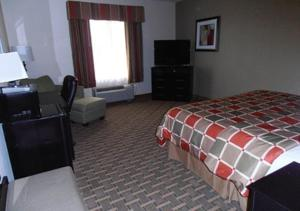 A bed or beds in a room at Americas Best Value Inn & Suites Port Arthur