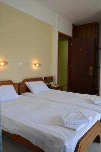 A bed or beds in a room at Elli Maria