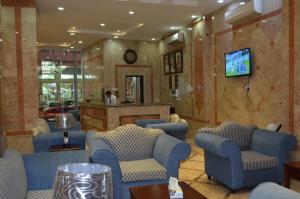 O lounge ou bar de Orchid Suites 3
