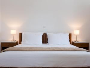 Ένα ή περισσότερα κρεβάτια σε δωμάτιο στο Janos Studios and Apartments