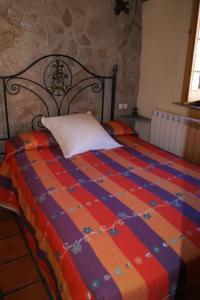 A bed or beds in a room at casa rural Aaiun