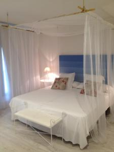 A bed or beds in a room at Can Segura Hotel