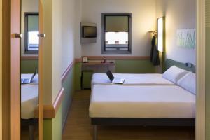 Letto o letti in una camera di Ibis Budget Sevilla Aeropuerto