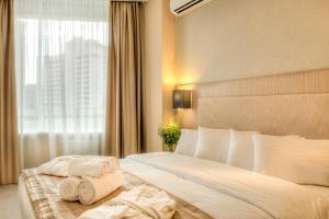 سرير أو أسرّة في غرفة في شقق بون أبارت