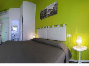 Ein Bett oder Betten in einem Zimmer der Unterkunft Hotel Casablanca