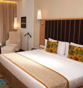 A bed or beds in a room at Radisson Blu Hotel Ranchi