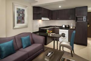A kitchen or kitchenette at Savoy Central Hotel Apartments