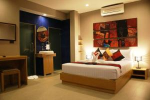 A bed or beds in a room at P10 Samui