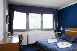 Ein Bett oder Betten in einem Zimmer der Unterkunft Hotel U Karla