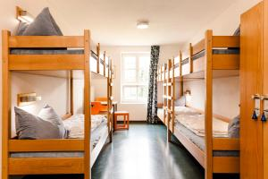 A bunk bed or bunk beds in a room at HI Youth Hostel Lindau