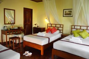 A bed or beds in a room at Villa Nam Song