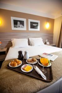 Cama ou camas em um quarto em Intercity Teresópolis
