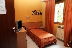 Letto o letti in una camera di Hotel Bicocca