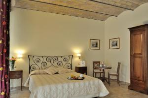 Letto o letti in una camera di Hotel Le Clarisse al Pantheon