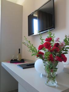 TV o dispositivi per l'intrattenimento presso Hotel Motel Piu'