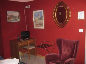 Телевизор и/или развлекательный центр в Hotel Ferraro