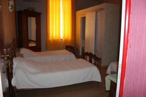 A bed or beds in a room at Hotel Restaurant La Camargue