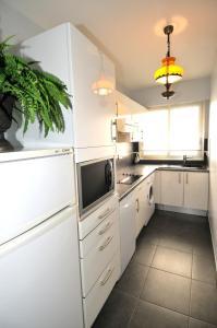 Cuisine ou kitchenette dans l'établissement Residence Le Minerve
