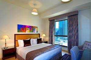 A bed or beds in a room at Roda Amwaj Suites Jumeirah Beach Residence