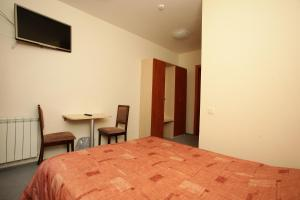 A bed or beds in a room at Guest House 21