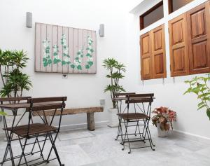 A porch or other outdoor area at Gingerflower Boutique Hotel