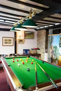 A pool table at Portway Inn