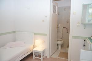 Ванная комната в Aegli Rooms