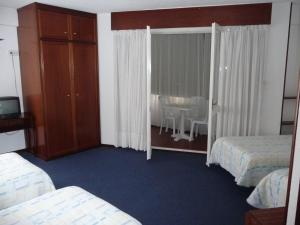 A bed or beds in a room at Hostal Liebana