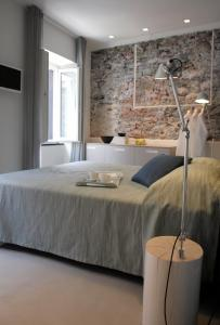 A bed or beds in a room at Hotel Marina Piccola