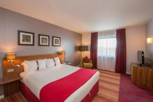 A bed or beds in a room at Holiday Inn Norwich City, an IHG Hotel