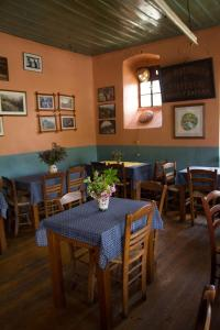 A restaurant or other place to eat at Napoleon Zaglis Guesthouse