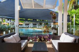 The swimming pool at or near Hotel Grand Chancellor Palm Cove
