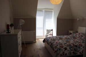 Łóżko lub łóżka w pokoju w obiekcie Apartament Jelitkowo
