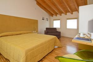 A bed or beds in a room at Stile Libero